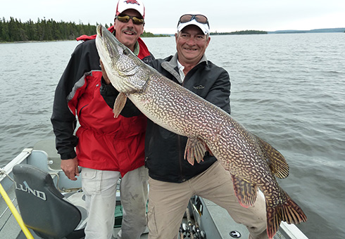 Two men with a trophy northern pike.