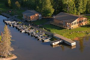An aerial view of the Lodge, tackle shop and 14 of our fishing boats.