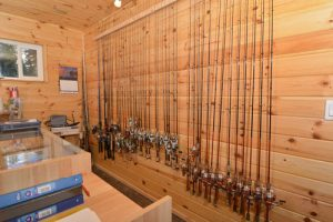 A wall of fishing rods available at our sport shop.